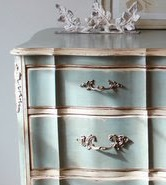 Custom dresser with tones of teal, gold leaf, and cottage white.