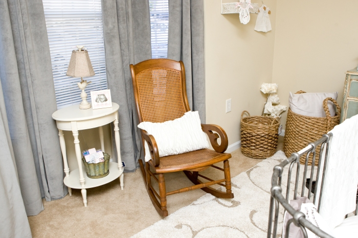 Nursing nook is comfortable and functional. Everything withing arm's reach is ideal for new moms.